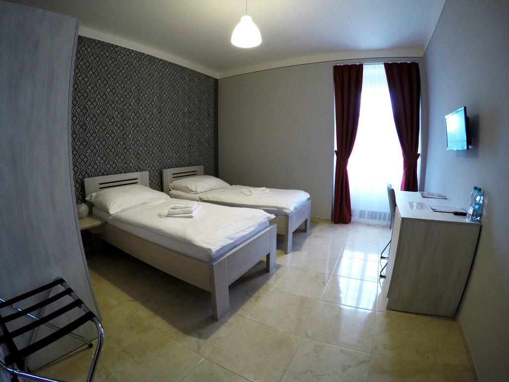 Dvoulůžkový pokoj s oddělenými postelemi (TWIN)